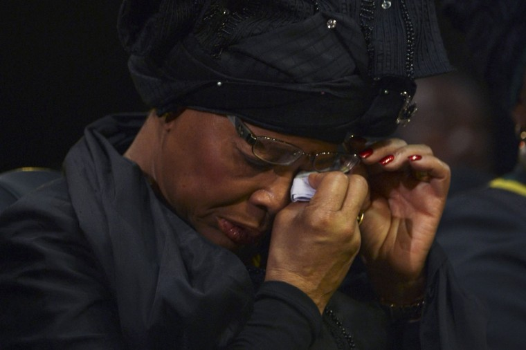 Graca Machel, widow of former South African President Nelson Mandela, wipes her tears during the funeral ceremony of Nelson Mandela in Qunu December 15, 2013. (Odd Andersen/Reuters)