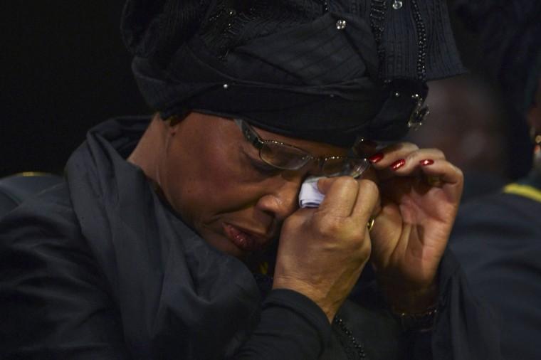 Graca Machel, widow of former South African President Nelson Mandela, wipes her tears during the funeral ceremony of Nelson Mandela in Qunu December 15, 2013. (Odd Andersen/Reuters)