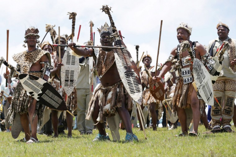 Zulu men perform a traditional dance on the hills above former South African President Nelson Mandela's home village during his state funeral December 15, 2013 in Qunu, South Africa. Mr. Mandela passed away on the evening of December 5, 2013 at his home in Houghton at the age of 95. Mandela became South Africa's first black president in 1994 after spending 27 years in jail for his activism against apartheid in a racially-divided South Africa. (Chip Somodevilla/Getty Images)