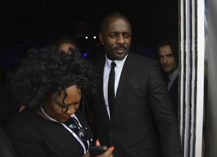 British actor Idris Elba leaves the funeral ceremony of former South African President Nelson Mandela in Qunu December 15, 2013. (Odd Andersen/Reuters)