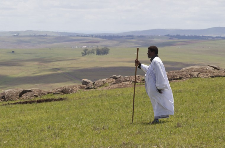 A Shembe devotee prays as he looks out towards the grave of former South African President Nelson Mandela in Qunu, December 15, 2013. (Rogan Ward/Reuters)