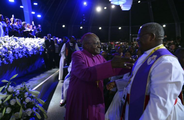Archbishop Desmond Tutu (center) arrives for the funeral ceremony of former South African President Nelson Mandela in Qunu December 15, 2013. (Odd Andersen/Reuters)