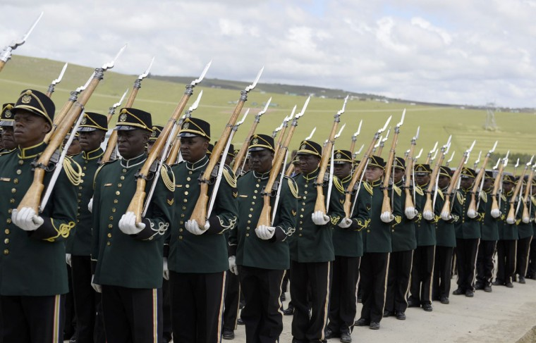 Presidential guards escort the coffin of former South African President Nelson Mandela during the funeral ceremony in Qunu December 15, 2013. (Odd Andersen/Reuters)