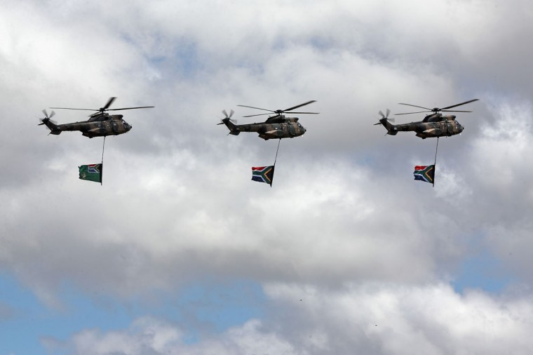 A military flypast as the funeral service of the former South African President Nelson Mandela takes place during his state funeral on December 15, 2013 in Qunu, South Africa. Mr. Mandela passed away on the evening of December 5, 2013 at his home in Houghton at the age of 95. Mandela became South Africa's first black president in 1994 after spending 27 years in jail for his activism against apartheid in a racially-divided South Africa. (Dan Kitwood/Getty Images)