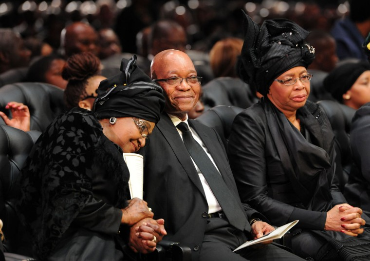 Nelson Mandela's ex-wife, Winnie Mandela Madikizela, South Africa President Jacob Zuma and Mandela's widow, Graca Machel, attend the funeral ceremony of South African former president Nelson Mandela in Qunu on December 15, 2013. (Felix Dlangamandla/AFP/Getty Images)