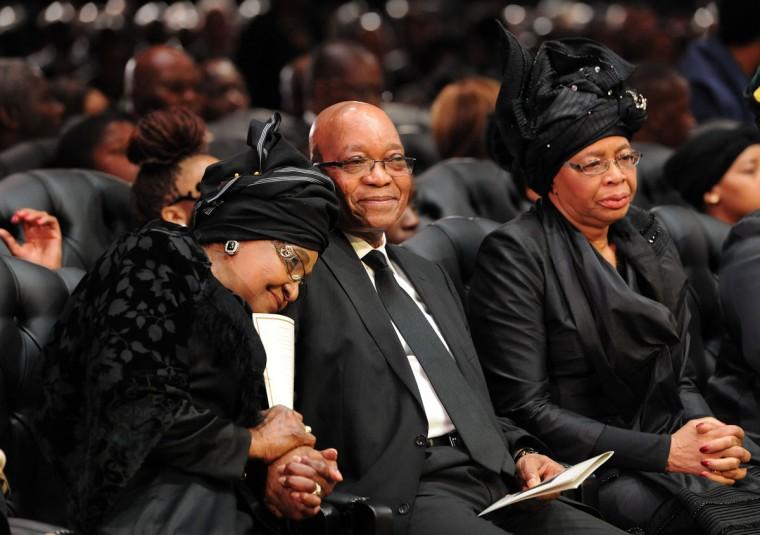 Nelson Mandela's ex-wife, Winnie Mandela Madikizela, South Africa President Jacob Zuma and Mandela's widow, Graca Machel, attend the funeral ceremony of South African former president Nelson Mandela in Qunu on December 15, 2013. (Felix Dlangamandla/AFP/Getty Images)