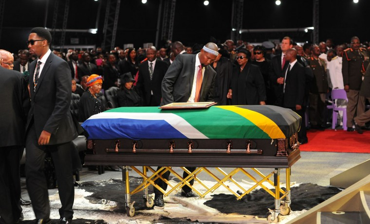 Nelson Mandela's grandson's Ndaba (left) and Mandla Mandela attend the funeral ceremony of South African former president Nelson Mandela in Qunu on December 15, 2013. South Africa's first black president Nelson Mandela received a tearful state funeral at his childhood village of Qunu on Sunday, followed by a traditional burial attended by family and friends. Mandela, the revered icon of the anti-apartheid struggle in South Africa and one of the towering political figures of the 20th century, died in Johannesburg on December 5 at age 95. (Felix Dlangamandla/AFP/Getty Images)