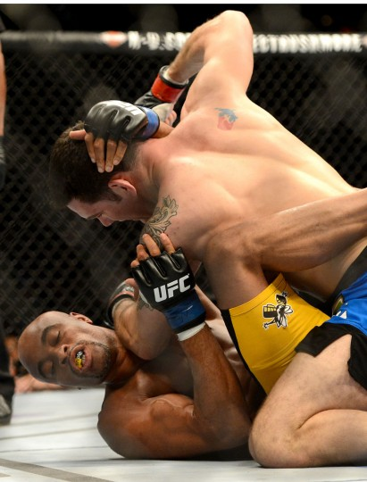 Chris Weidman (red gloves) and Anderson Silva (blue gloves) fight during their UFC middleweight championship bout at the MGM Grand Garden Arena. Weidman won. (Jayne Kamin-Oncea/USA TODAY Sports )