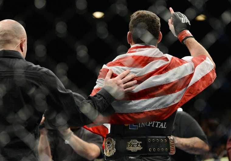 Chris Weidman reacts in the cage after defeating Anderson Silva (not pictured) in their UFC middleweight championship bout at the MGM Grand Garden Arena. (Jayne Kamin-Oncea/USA TODAY Sports)