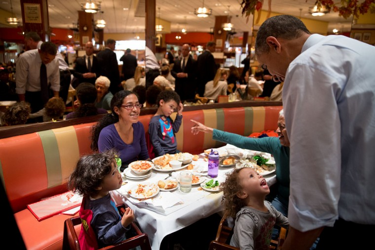 "Oct. 25, 2013 ""A young girl captures the President's attention as he greeted customers at Junior's Cheesecake with New York City mayoral candidate Bill de Blasio in Brooklyn."" (Official White House Photo by Pete Souza)"