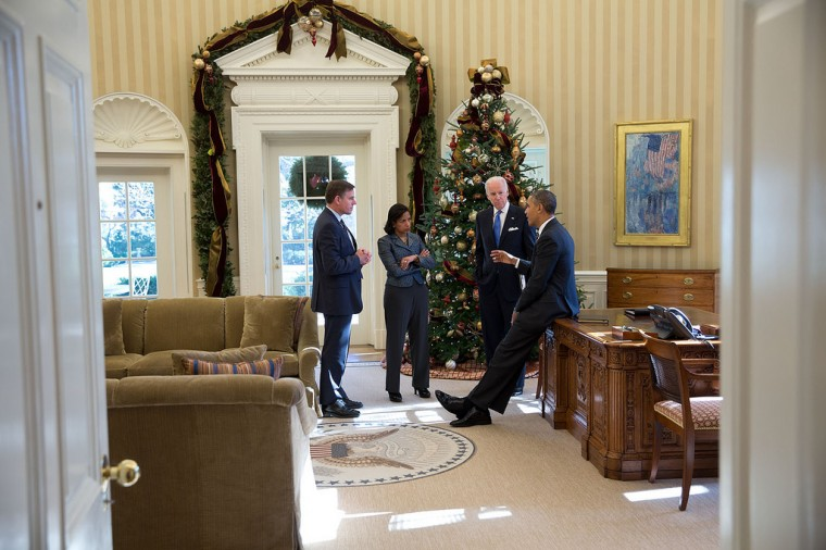 "Dec. 13, 2013 ""The President discusses Afghanistan with the Vice President, Susan Rice and Jeff Eggers in the Christmas-decorated Oval Office."" (Official White House Photo by Pete Souza)"