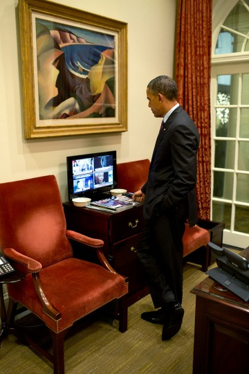 "Dec. 5, 2013 ""The President watches news coverage of the passing of Nelson Mandela, in the Outer Oval Office."" (Official White House Photo by Pete Souza)"