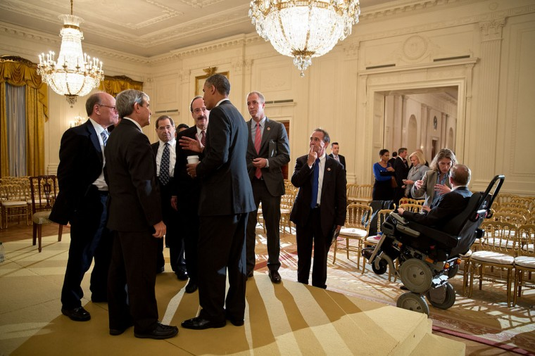 "Oct. 9, 2013 ""I often say that sometimes the best pictures are either before or after a meeting, not during the meeting itself. Here, the President talks with members of the House Democratic Caucus in the East Room following their more formal meeting to discuss the government shutdown."" (Official White House Photo by Pete Souza)"