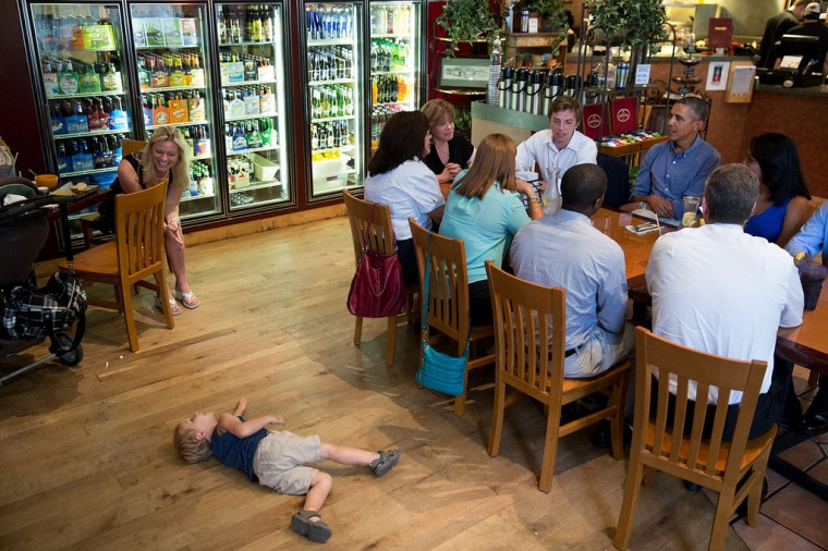 "Aug. 22, 2013 ""You can't always predict what will happen even when the President has a pre-arranged lunch during a stop on his college affordability college tour. Here, during a lunch with college students, recent graduates and educators, a young child plays on the floor nearby at Magnolia's Deli & Cafe in Rochester, N.Y."" (Official White House Photo by Pete Souza)"