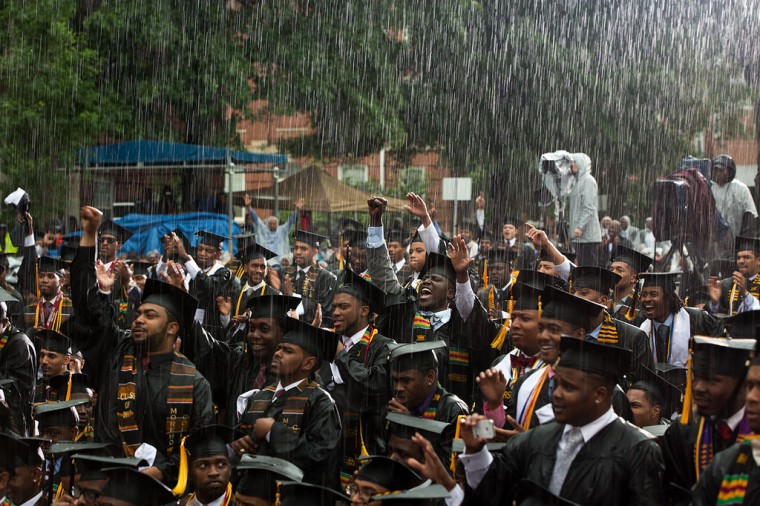 "May 19, 2013 ""Graduates react in the pouring rain as the President delivered remarks during the commencement ceremony at Morehouse College in Atlanta, Ga. Officials from the college wanted the event to proceed outside because they did not have an indoor facility available for this many people."" (Official White House Photo by Pete Souza)"