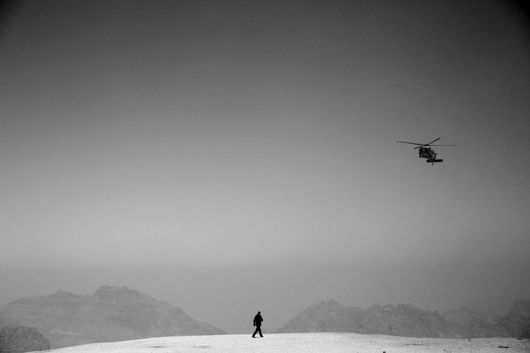 "March 23, 2013 ""I was on the second helicopter which landed minutes before Marine One, and then photographed the President's helicopter as it descended into a landing zone outside of Petra, Jordan."" (Official White House Photo by Pete Souza)"