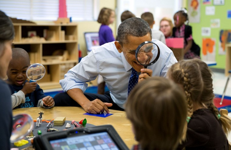 "Feb. 14, 2013 ""The President genuinely enjoys being with kids. Here, he played a magnifying glass game with children during a visit to a pre-kindergarten classroom at the College Heights Early Childhood Learning Center in Decatur, Georgia."" (Official White House Photo by Pete Souza)"