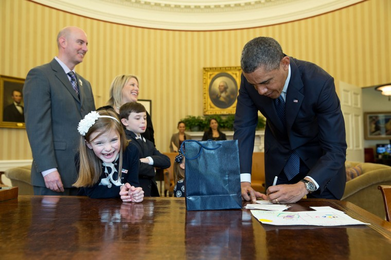 "March 26, 2013 ""The President signs memorabilia in the Oval Office for an overjoyed Nina Centofanti, 8, the 2013 March of Dimes National Ambassador."" (Official White House Photo by Pete Souza)"