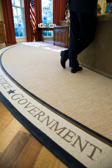 "Nov. 14, 2013 ""The feet of Denis McDonough during a meeting in the Oval Office. The rug has several quotations around its perimeter, including one from Abraham Lincoln which begins with the word 'Government,' and reads in full, ""Government of the People, By the People, For the People.'"" (Official White House Photo by Pete Souza)"
