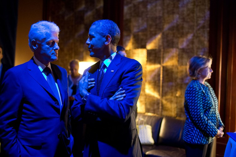 "Sept. 24, 2013 ""The President and former President Bill Clinton are bathed in blue light as they talk backstage prior to participating in the Clinton Global Initiative Healthcare Forum in New York City. Former Secretary of State Hillary Rodham Clinton, right, waits to introduce them."" (Official White House Photo by Pete Souza)"