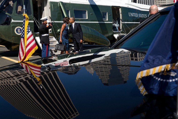 "Sept. 23, 2013 ""The President and First Lady kiss before departing for separate events after arriving at the Wall Street Landing Zone aboard Marine One in New York."" (Official White House Photo by Pete Souza)"