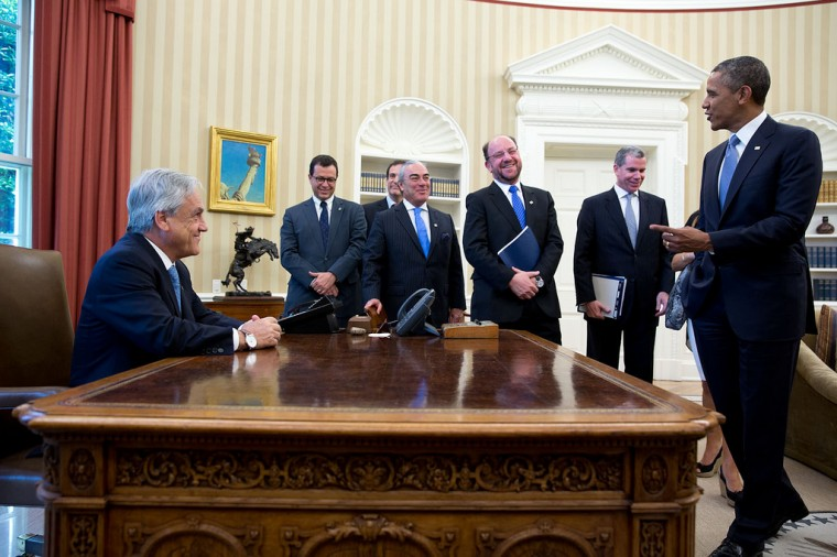 "June 4, 2013 ""Following their bilateral meeting, then President of Chile Sebastion Pinera asked the President if he could sit in his chair at the Resolute Desk."" (Official White House Photo by Pete Souza)"