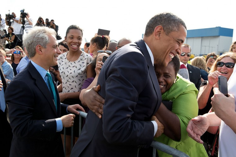 "May 29, 2013 ""A woman hugs the President as he and Chicago Mayor Rahm Emanuel greeted people on the tarmac at O'Hare International Airport in Chicago."" (Official White House Photo by Pete Souza)"