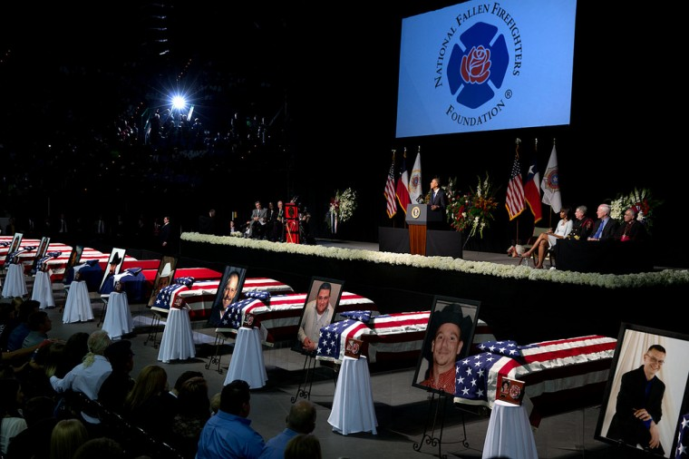 "April 25, 2013 ""The President and First Lady attend a memorial service in Waco, Texas, for the firefighters and first responders who died at a fertilizer plant explosion the week before In West, Texas. A day that began with laughter at the Bush Presidential Library ended in tears as the Obamas also met privately with the families who lost loved ones."" (Official White House Photo by Pete Souza)"