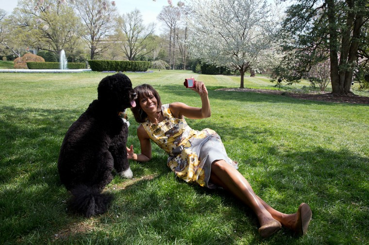 "April 11, 2013 ""Chuck Kennedy photographed the First Lady as she takes a 'selfie' with Bo, the Obama family dog, for National Geographic."" (Official White House Photo by Chuck Kennedy)"
