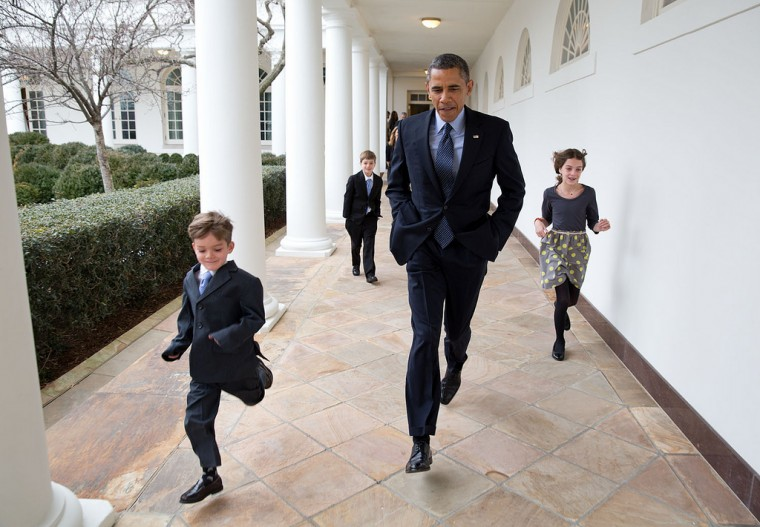 "Jan. 25, 2013 ""On a cold day, the President races down the Colonnade with Denis McDonough's children en route to the announcement that Denis would become the new Chief of Staff."" (Official White House Photo by Pete Souza)"