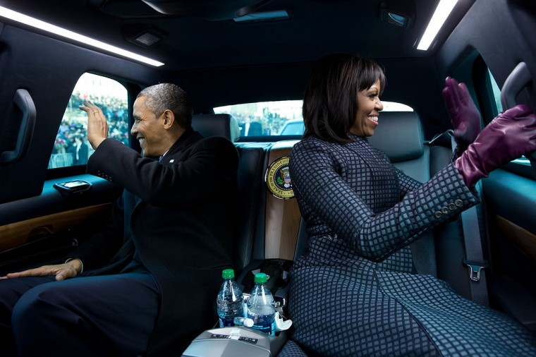 "Jan. 2, 2013 ""The President and First Lady wave to supporters as they ride in the inaugural parade. I had asked the President if I could ride in the presidential limousine and the President joked, 'But Michelle and I were planning to make out.'"" (Official White House Photo by Pete Souza)"