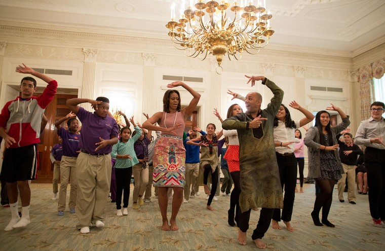 "Nov. 5, 2013 ""Chuck Kennedy made this photograph in the State Dining Room of the First Lady, choreographer Nakul Dev Mahajan, and students for a Bollywood Dance Clinic at the White House."" (Official White House Photo by Chuck Kennedy)"