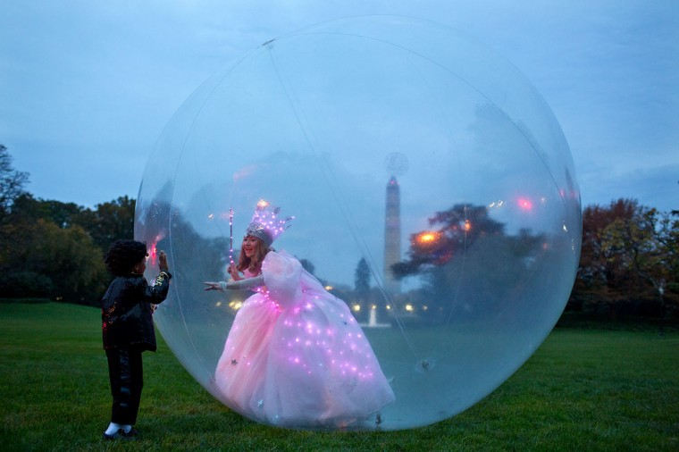 "Oct, 31, 2013 ""I was headed back into the White House after the President and First Lady had finished handing out Halloween treats on the South Lawn, when I noticed 'Glinda the Good Witch' greeting youngsters from inside her bubble."" (Official White House Photo by Pete Souza)"
