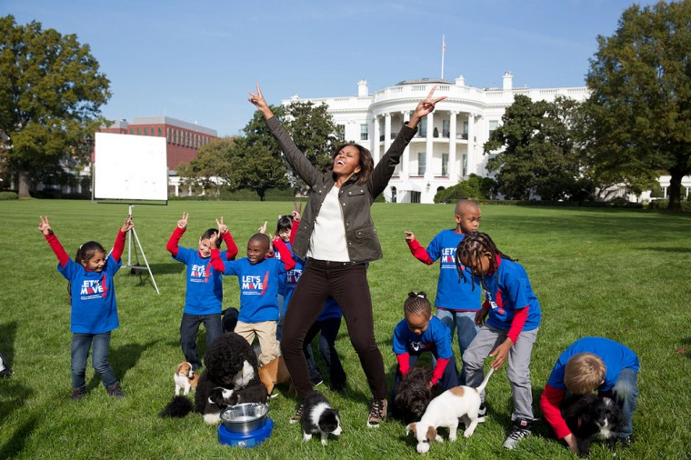 "Oct. 28, 2013 ""Amanda Lucidon made this photograph of the First Lady as she participated in a filming for the Animal Planet Puppy Bowl on the South Lawn of the White House."" (Official White House Photo by Amanda Lucidon)"