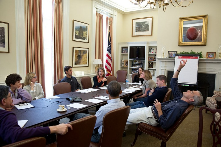 "Oct. 12, 2013 ""Chief of Staff Denis McDonough throws a football in the air as the President met with senior staff in Denis's office to discuss the federal government shutdown and debt ceiling deadline. That football got a lot of use during meetings in September and October."" (Official White House Photo by Pete Souza)"