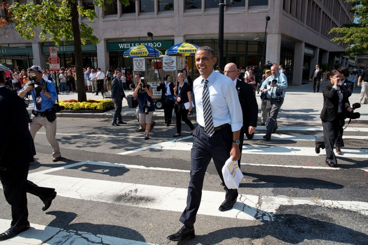 "Oct. 4, 2013 ""The President walks back to the White House from Taylor Gourmet, a sandwich shop near the intersection of 17th and Pennsylvania Avenues, Washington, D.C. The President wanted to thank the sandwich shop for offering discounts to furloughed government workers during the shutdown."" (Official White House Photo by Pete Souza)"