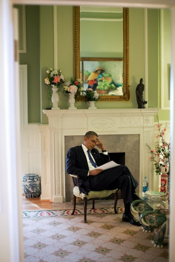 "Sept. 22, 2013 ""The President edits his speech before delivering remarks at a memorial service for victims of the Washington Navy Yard shootings. It is not uncommon for the President to be making final edits to a speech only moments before being introduced. Such was the case here."" (Official White House Photo by Pete Souza)"