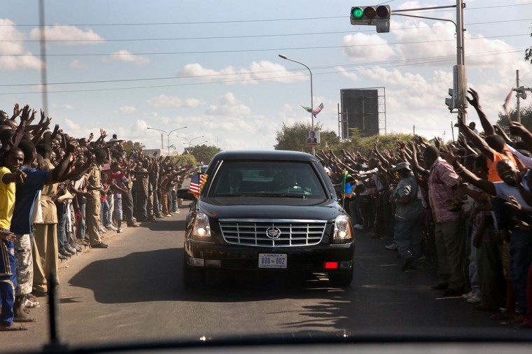 "July 1, 2013 ""Thousands of people lined the streets as the President's motorcade makes its way to the State House in Dar es Salaam, Tanzania. This could have been a dangerous situation as local security were unable to keep people back away from the speeding cars."" (Official White House Photo by Pete Souza)"