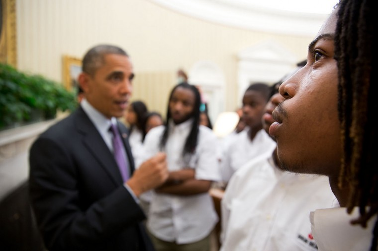 "June 5, 2013 ""A student eyes the Emancipation Proclamation as the President gave students from William R. Harper High School in Chicago a tour of the Oval Office."" (Official White House Photo by Pete Souza)"