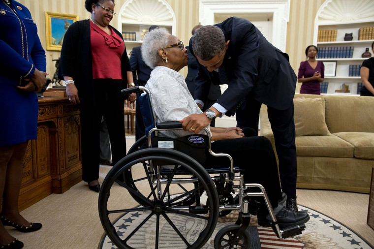 "May 24, 2013 ""Thelma Maxine Pippen McNair, mother of Denise McNair, whispers to the President after he signed H.R. 360, which provided for the presentation of a congressional gold medal to commemorate the lives of the four young African American victims of the bombing of the Sixteenth Street Baptist Church in Birmingham, Alabama, in September 1963. McNair's daughter was one of the victims."" (Official White House Photo by Pete Souza)"