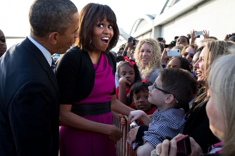 "April 24, 2013 ""The First Lady reacts while talking with a youngster along a rope line with the President at Love Field Airport in Dallas, Texas."" (Official White House Photo by Pete Souza)"