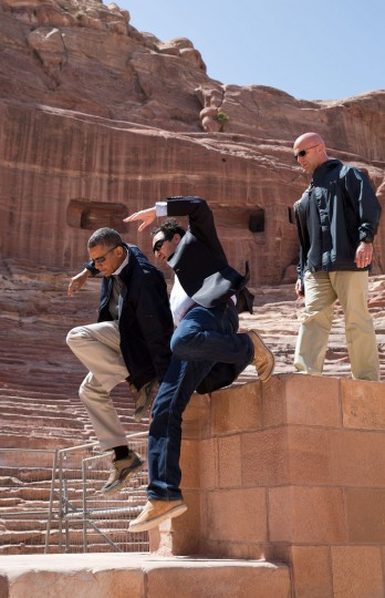 "March 23, 2013 ""While touring the ancient city of Petra in Jordan, the President and Dr. Suleiman A.D. Al Farajat, a University of Jordan tourism professor, jumped from a ledge of the Nabataean Amphitheater."" (Official White House Photo by Pete Souza)"