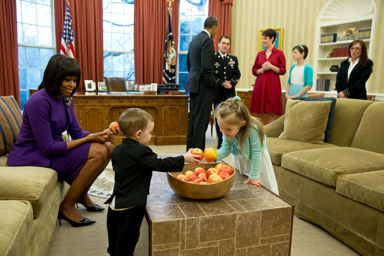 "Feb. 11, 2013 ""The First Lady watches as the children of former Staff Sergeant Clinton Romesha choose apples in the Oval Office. The President later awarded SSG. Romesha the Medal of Honor for conspicuous gallantry."" (Official White House Photo by Pete Souza)"