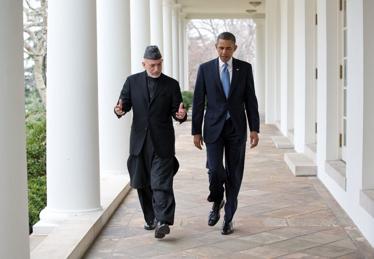 "Jan.11, 2013 ""President Obama walks with President Hamid Karzai of Afghanistan on the White House Colonnade after their meeting in the Oval Office. Afghanistan continued to occupy a lot of the President's time during 2013."" (Official White House Photo by Pete Souza)"