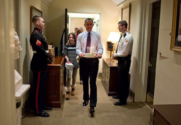 "Dec. 2, 2013 ""Joined by Chief of Staff Denis McDonough's daughter, the President carries a birthday cake to surprise McDonough in his West Wing office."" (Official White House Photo by Pete Souza)"