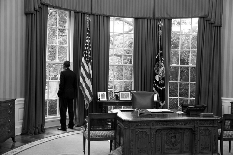 "Aug. 29, 2013 ""While waiting to call a foreign head of state to discuss the situation in Syria, I noticed the President looking out the window of the Oval Office."" (Official White House Photo)"