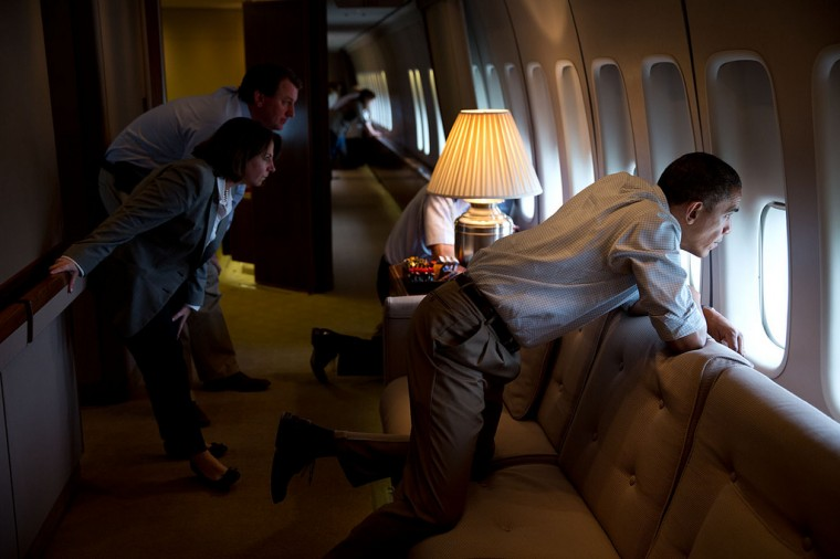 "May 26, 2013 ""The President and members of the White House staff look out the window of Air Force One to view tornado damage over Moore, Oklahoma. After landing at Tinker Air Base, the President did a walking tour of the damage and met with those affected."" (Official White House Photo by Pete Souza)"