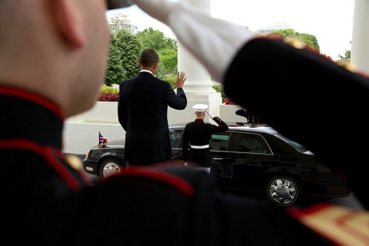 "May 13, 2013 ""The President waves farewell to British Prime Minister David Cameron as his motorcade departs the North Portico of the White House."" (Official White House Photo by Pete Souza)"
