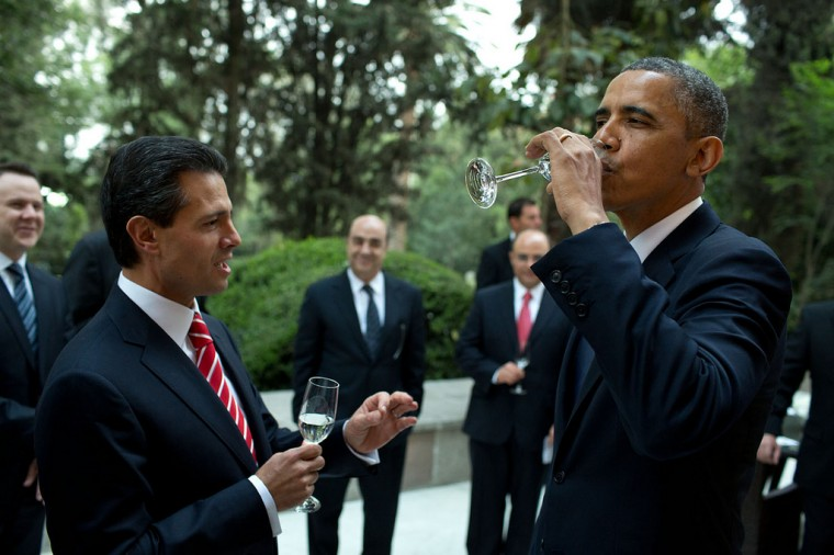 "May 2, 2013 ""The President tastes a sip of tequila as the urging of President Enrique Pena Nieto of Mexico prior to a working dinner at Los Pinos in Mexico City."" (Official White House Photo by Pete Souza)"