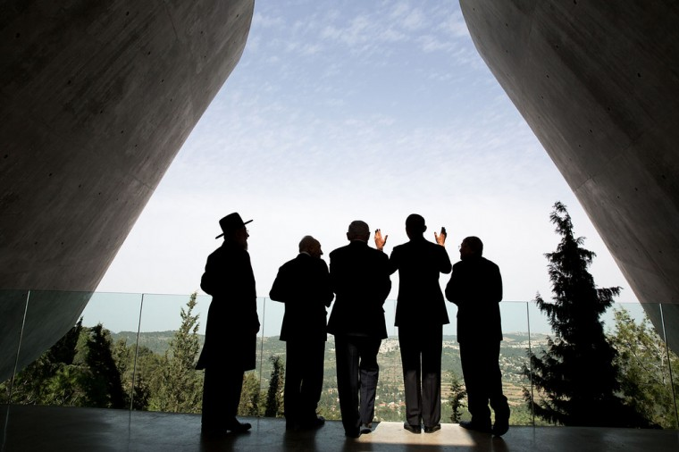 "March 22, 2013 ""The President was visiting the Yad Vashem Holocaust History Museum with Israeli President Shimon Peres, Israeli Prime Minster Benjamin Netanyahu, and others. When the President asked a question about the cityscape in the background, the sunlight lit up his hands adding another dimension to this photograph."" (Official White House Photo by Pete Souza)"
